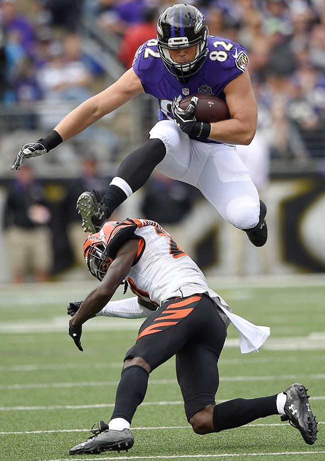 Baltimore tight end Nick Boyle leaps over Cincinnati cornerback Dre Kirkpatrick.