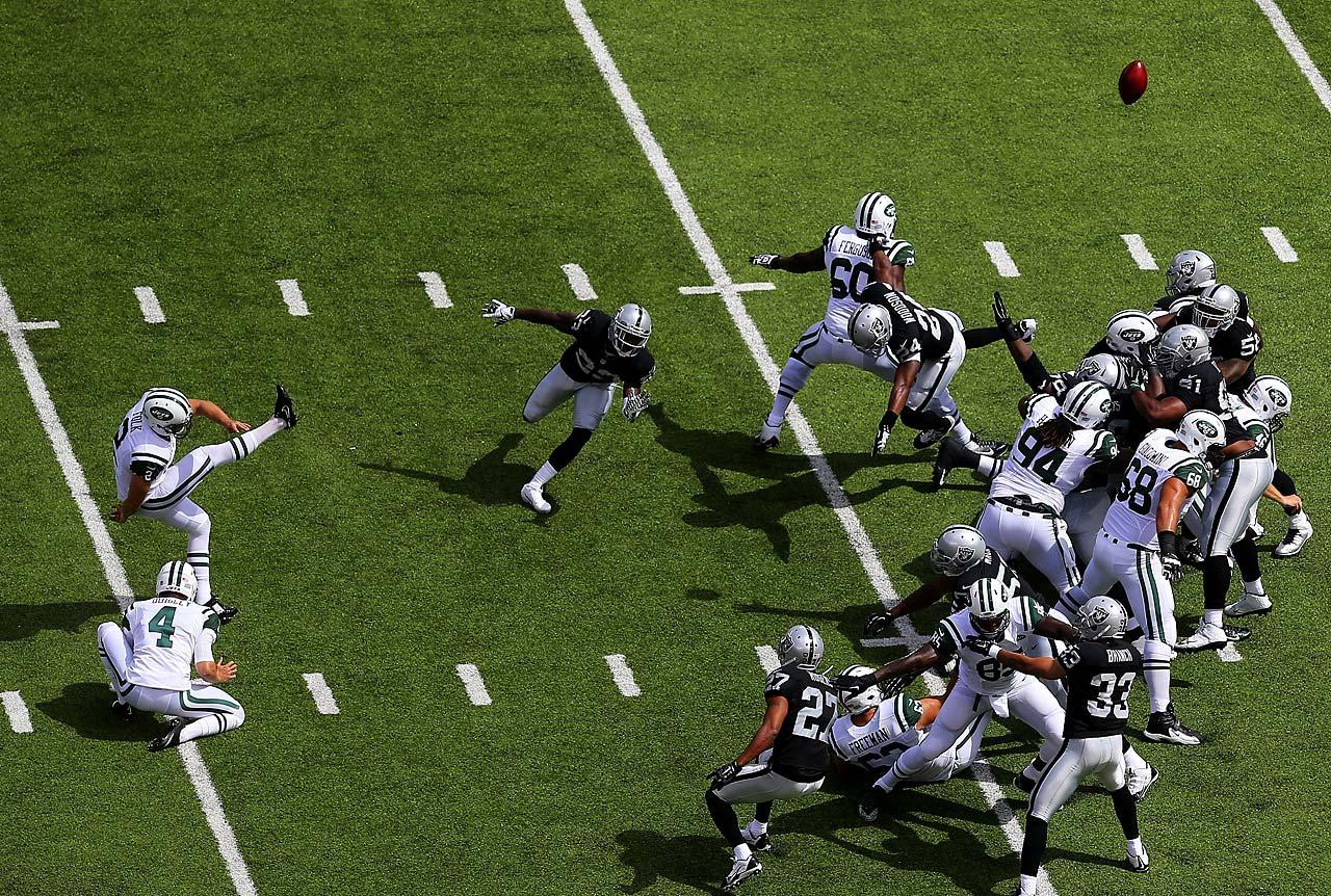 Nick Folk of the New York Jets kicks a field goal against the Oakland Raiders.
