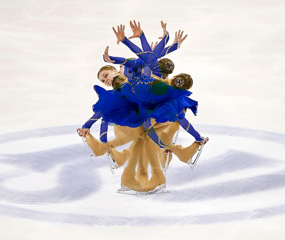 Multiple exposure of Nicole Rajicova performing in the Short Program of the 2015 ISU World Figure Skating Championships.