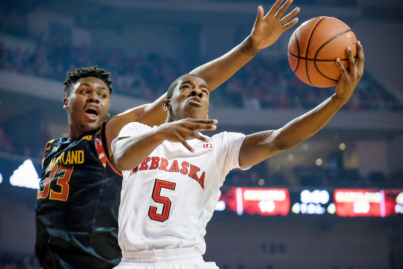 Glynn Watson Jr. of the Nebraska Cornhuskers drives to the basket past Diamond Stone of the Maryland Terrapins during their game at Pinnacle Bank Arena in Omaha.