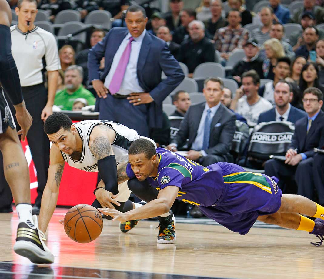 Danny Green of the San Antonio Spurs dives for the ball against Bryce Dejean-Jones of the New Orleans Pelicans at AT&T Center in San Antonio.