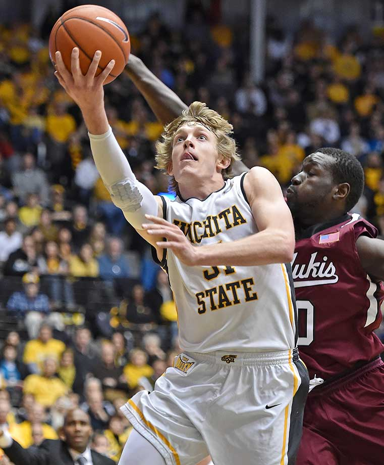 Guard Ron Baker of the Wichita State Shockers drives to the basket against the Southern Illinois Salukis at Charles Koch Arena in Wichita, Kan.