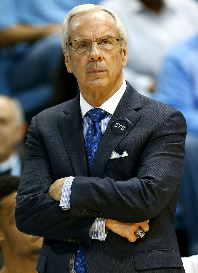 North Carolina head coach Roy Williams wears a STU patch on his coat in memory of Stuart Scott during the Tar Heels game against Notre Dame at Dean Smith Center on Jan. 5, 2015 in Chapel Hill, N.C.