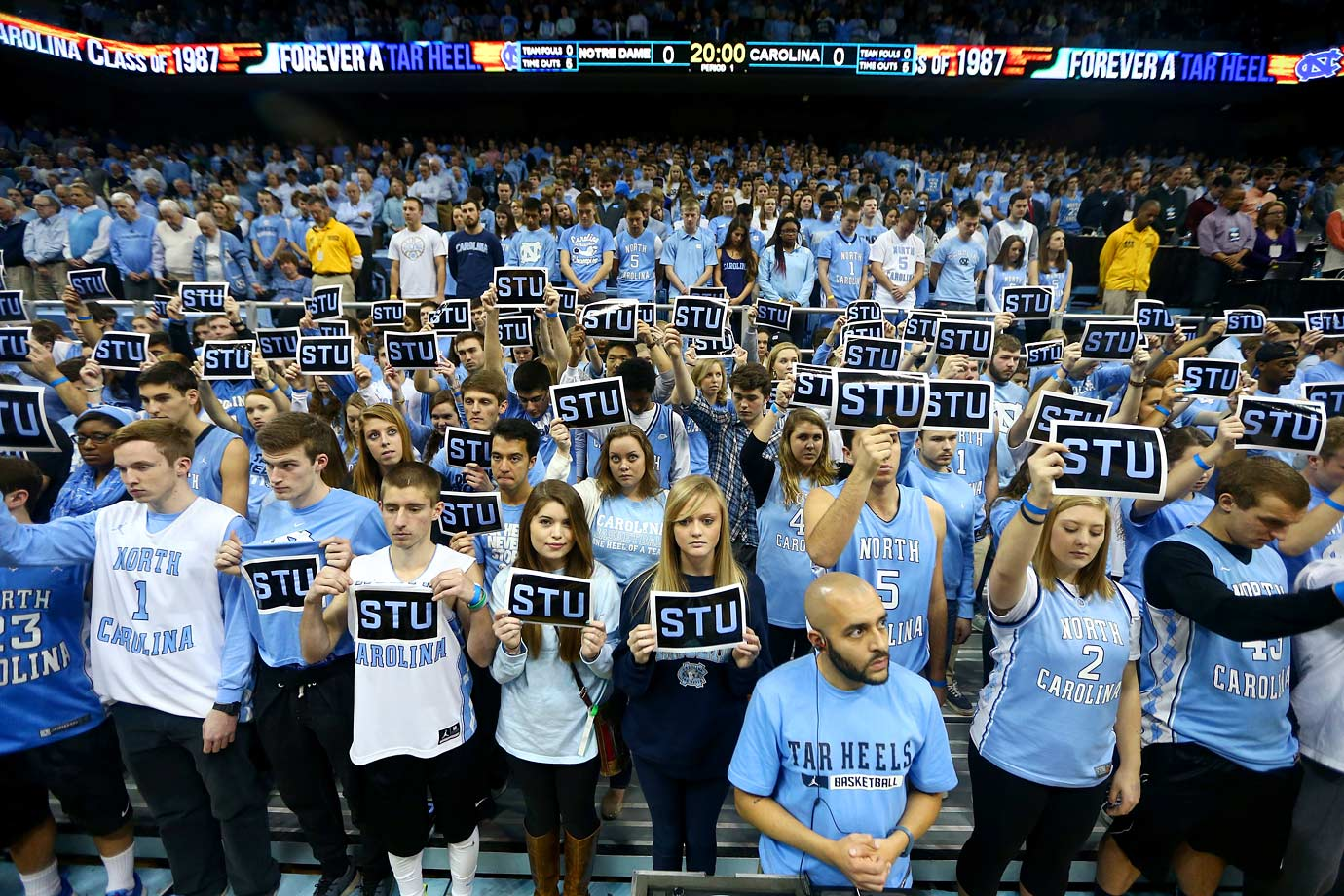 North Carolina fans honor Tar Heel alum Stuart Scott during a moment of silence before their game against Notre Dame at Dean Smith Center on Jan. 5, 2015 in Chapel Hill, N.C.