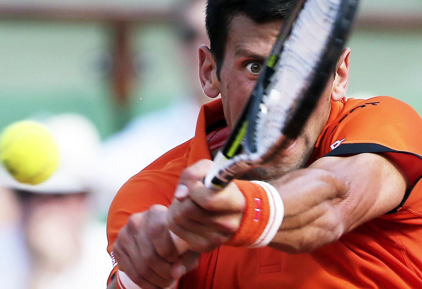 Novak Djokovic makes a feverish return to Andy Murray in the French Open semifinal match at the Roland Garros stadium in Paris on June 5.