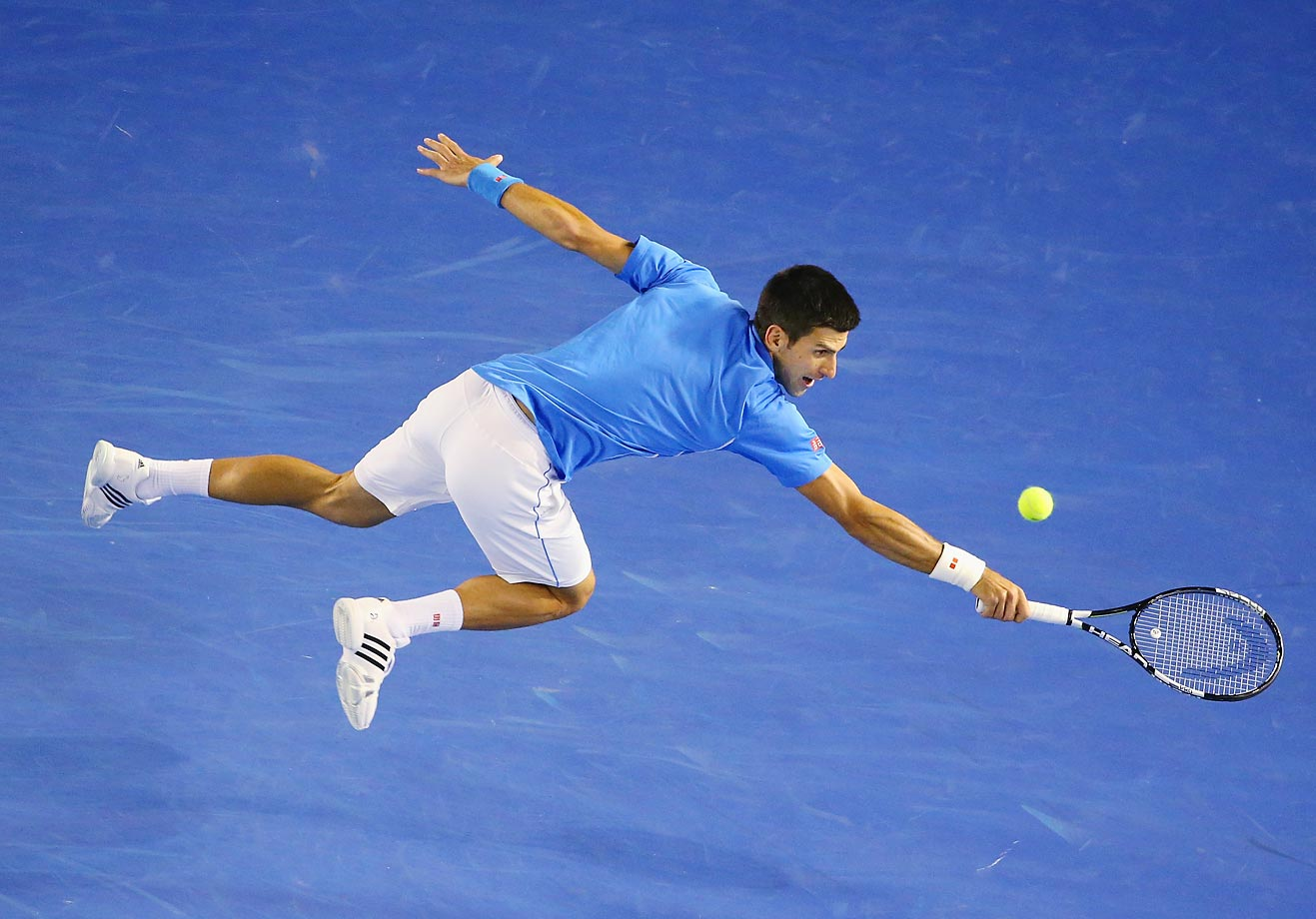 Novak Djokovic stretches for a backhand in his match against Milos Raonic at the Australian Open.