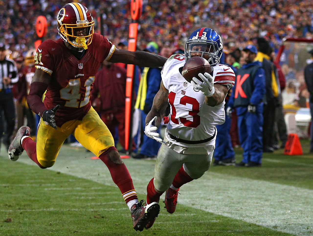 Nov. 29, 2015: Odell Beckham of the New York Giants scores a fourth-quarter touchdown past cornerback Will Blackmon of the Washington Redskins.