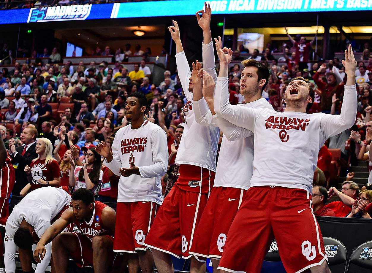 Oklahoma's bench celebrates during the 12-point victory that set up a Final Four date against Villanova.