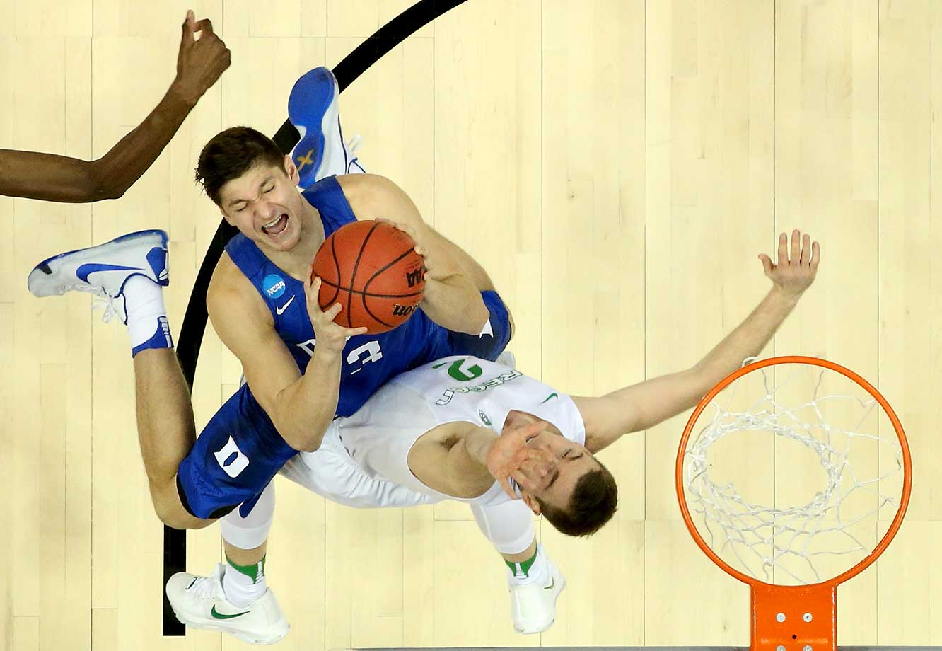 Grayson Allen of Duke goes up for a shot against Casey Benson of the Oregon Ducks.