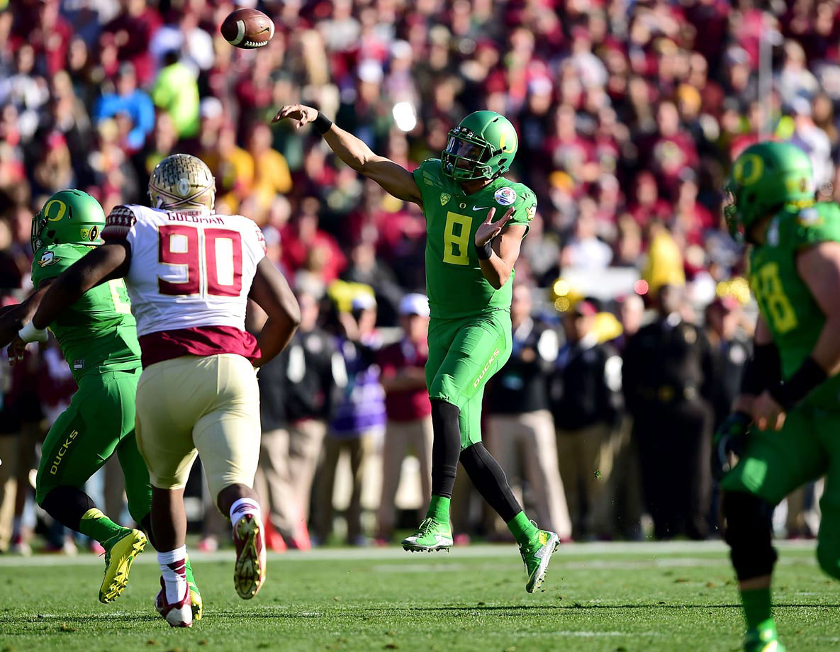 Marcus Mariota directed the Ducks' warp-speed, hurry-up offense, passing for 338 yards and two touchdowns.