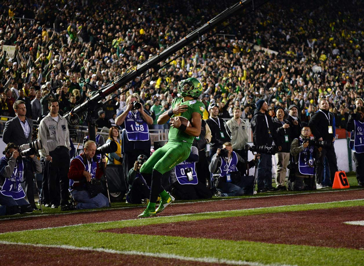 When Mariota sprinted for a 23-yard touchdown with 13:56 left in the fourth quarter it made the score 52-20 and it made the Ducks the first team to reach 50 points in Rose Bowl history.