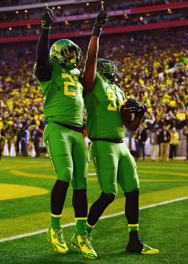 Washington celebrates his fumble return for a touchdown, which put Oregon up 45-20.