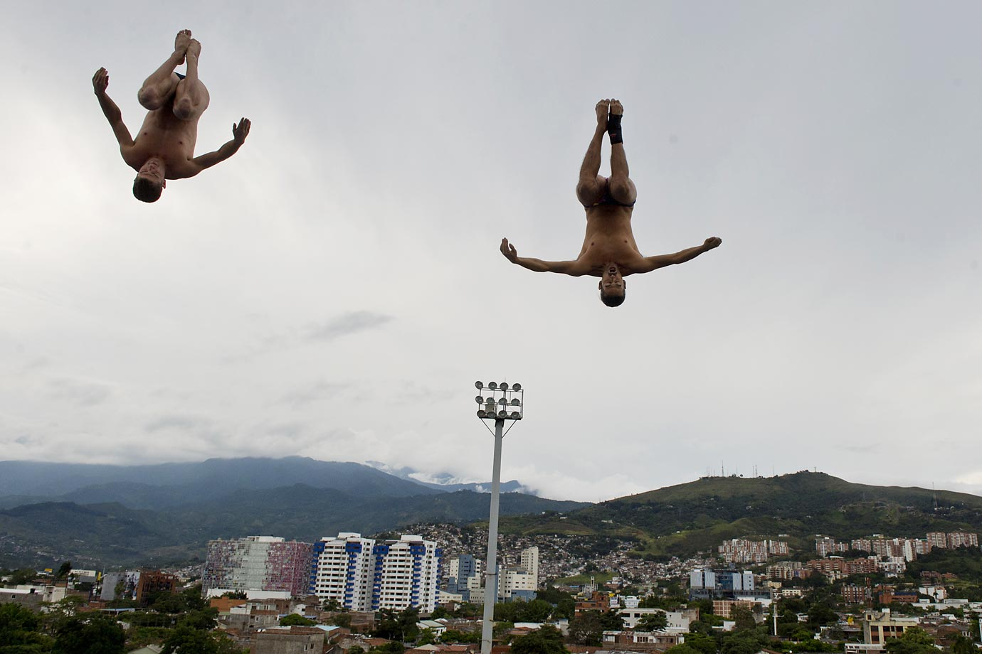 Orlando Duque (right) of Colombia and David Culturi of the U.S. make a jump from the 27-meter-high platform during the Red Bull Qualifier Cliff Diving World Series.