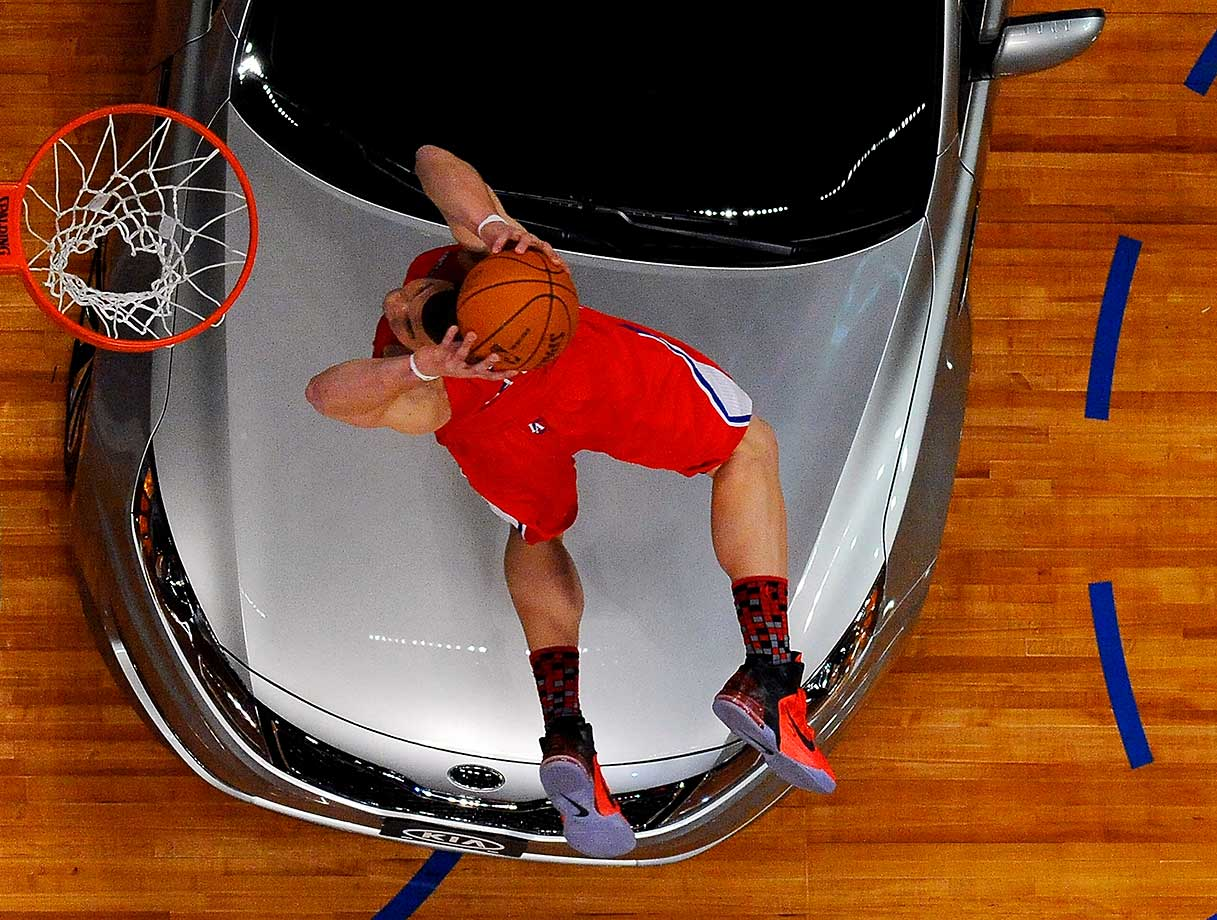 Blake Griffin of the Los Angeles Clippers dunks the ball over a car in the final round of the 2011 NBA Slam Dunk contest.