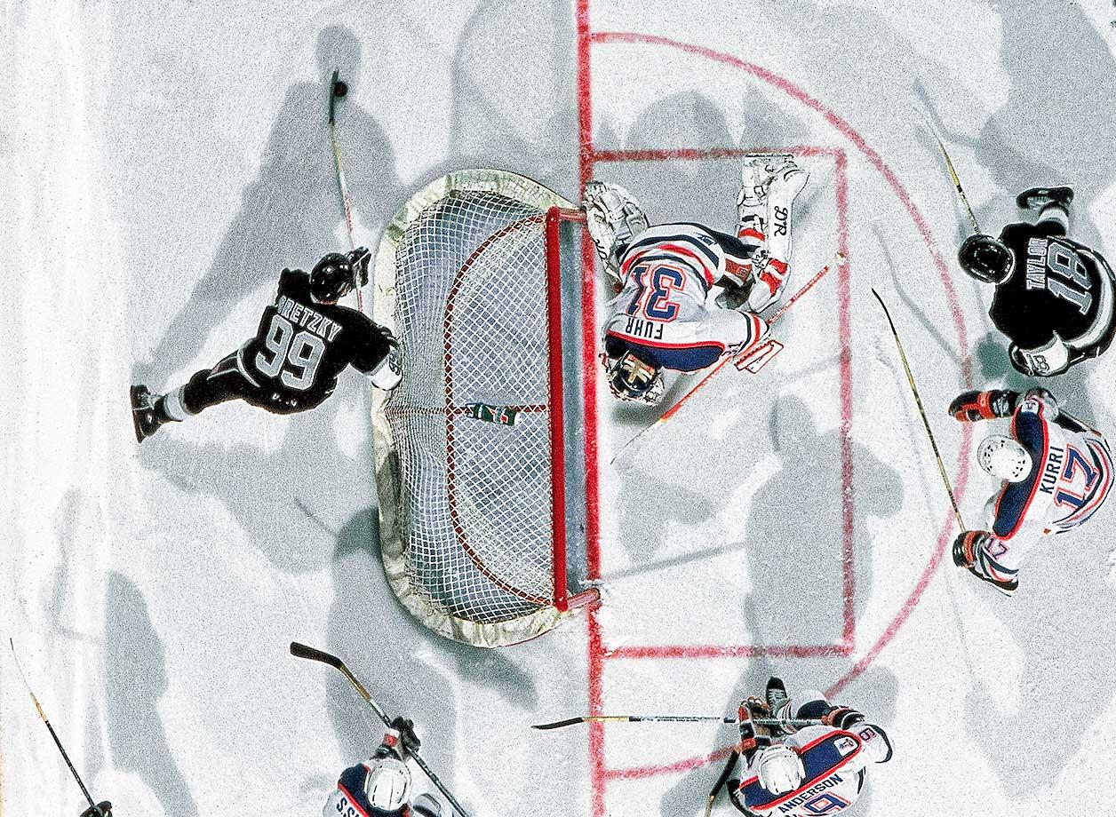 Wayne Gretzky of the Los Angeles Kings in action vs. Edmonton Oilers goalie Grant Fuhr in 1998.