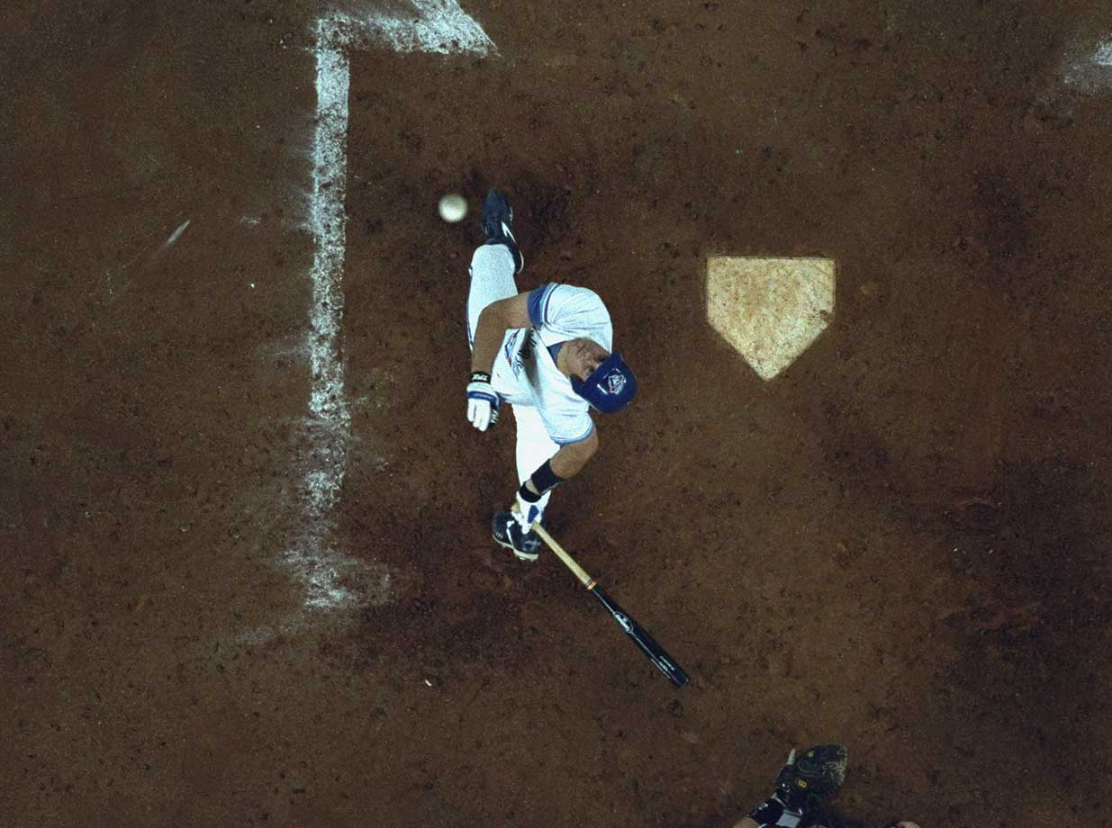 Ed Sprague of the Toronto Blue Jays watches a foul ball off his bat during the 1993 American League playoffs.