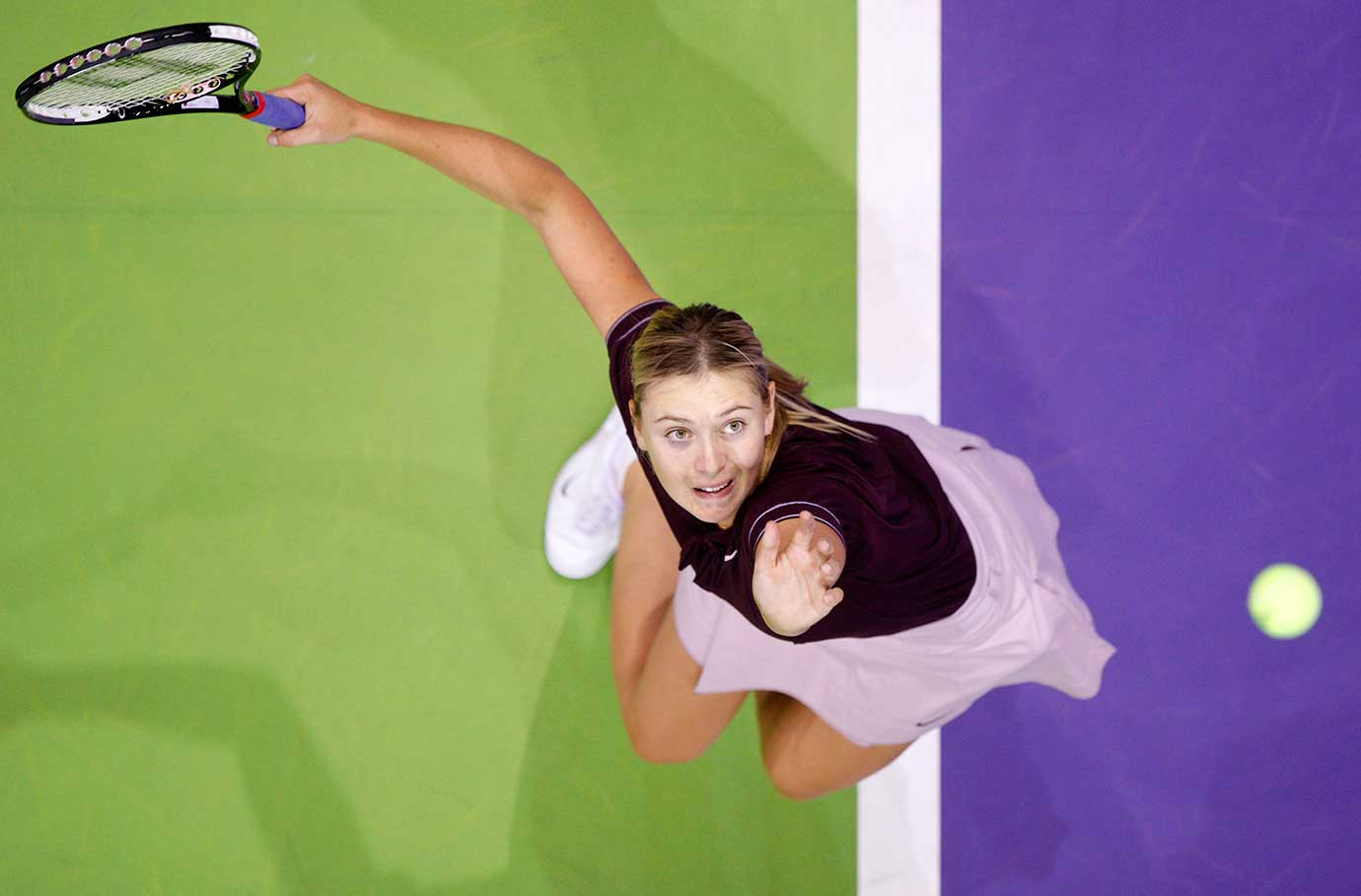 Maria Sharapova serves to Justine Henin at the 2007 Sony Ericsson WTA Tour Championships in Madrid, Spain.