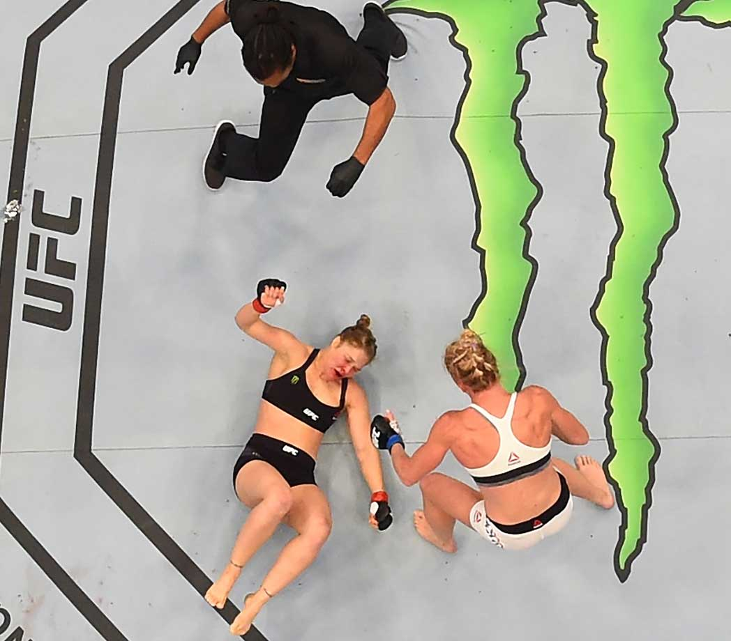 Holly Holm stands over a knocked ouyt Ronda Rousey at UFC 193, held in Melbourne, Australia, in November 2015.