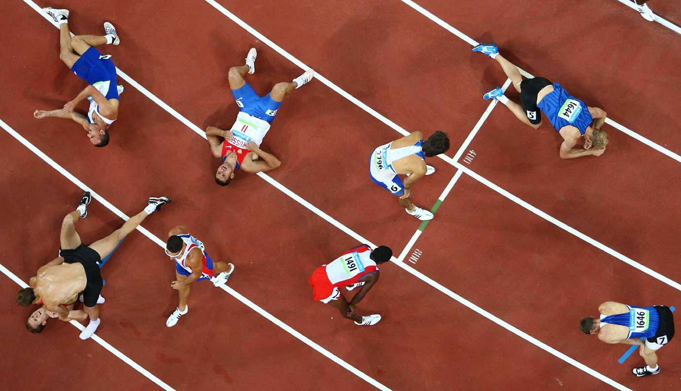 Worn out decathletes after the 1,500-meter run at the Beijing 2008 Summer Olympic Games.