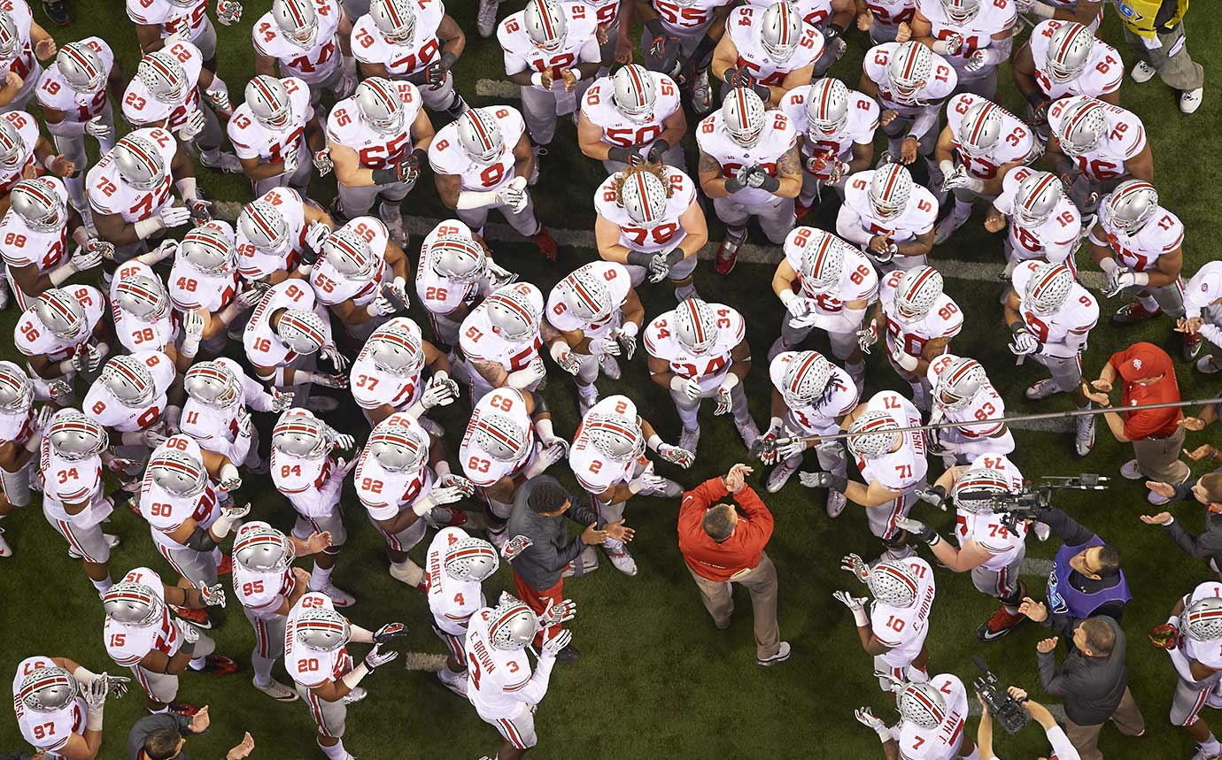 Ohio State head coach Urban Meyer with his players before a playoff game vs Michigan State at Lucas Oil Stadium.