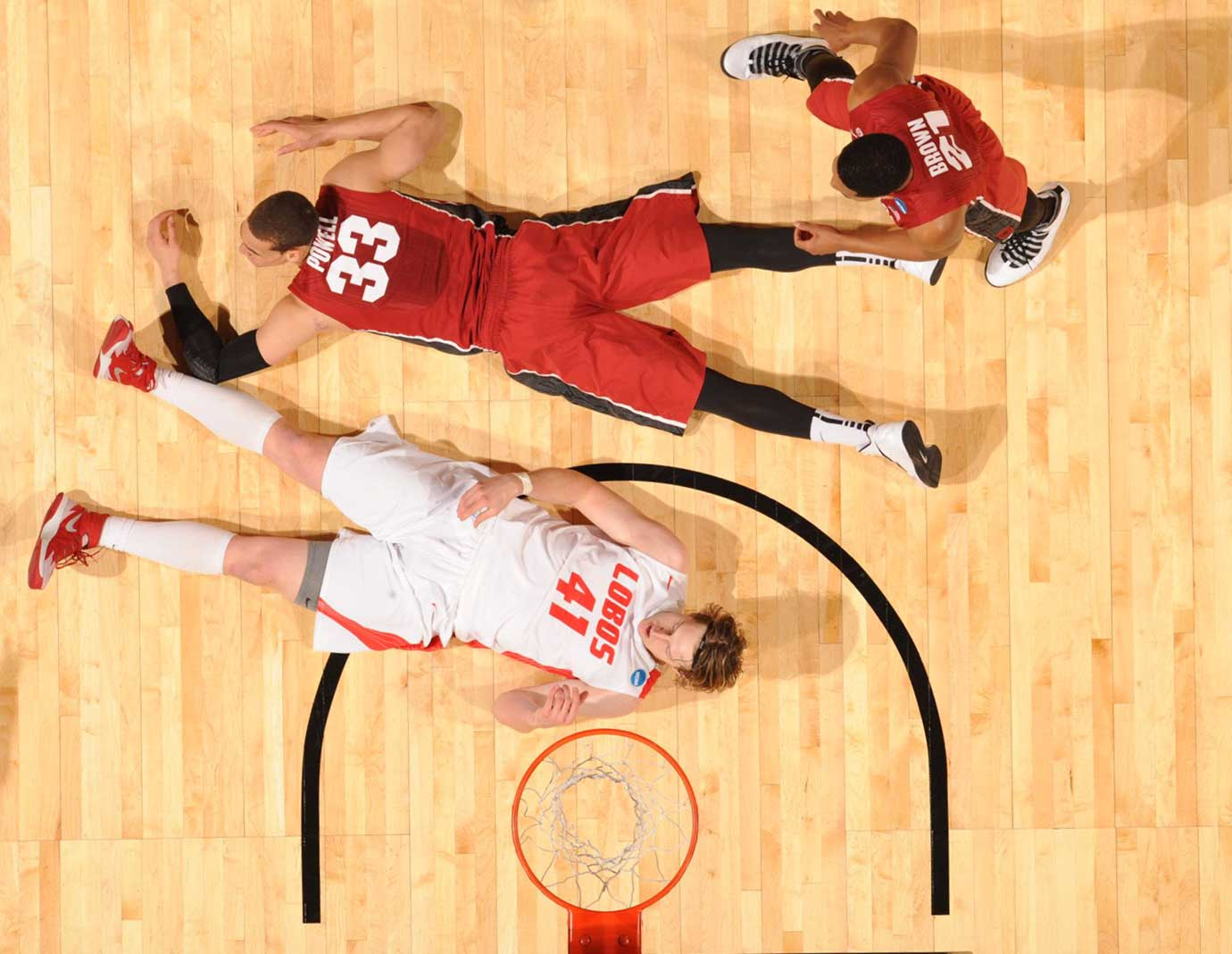 New Mexico's Cameron Bairstow (41) and Stanford's Dwight Powell during the 2014 NCAA Tournament.