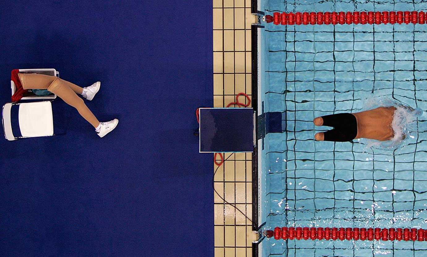 Hungary swimmer Ervin Kovacs starts the 200-meter freestyle SM5 at the 2004 Paralympic Games.