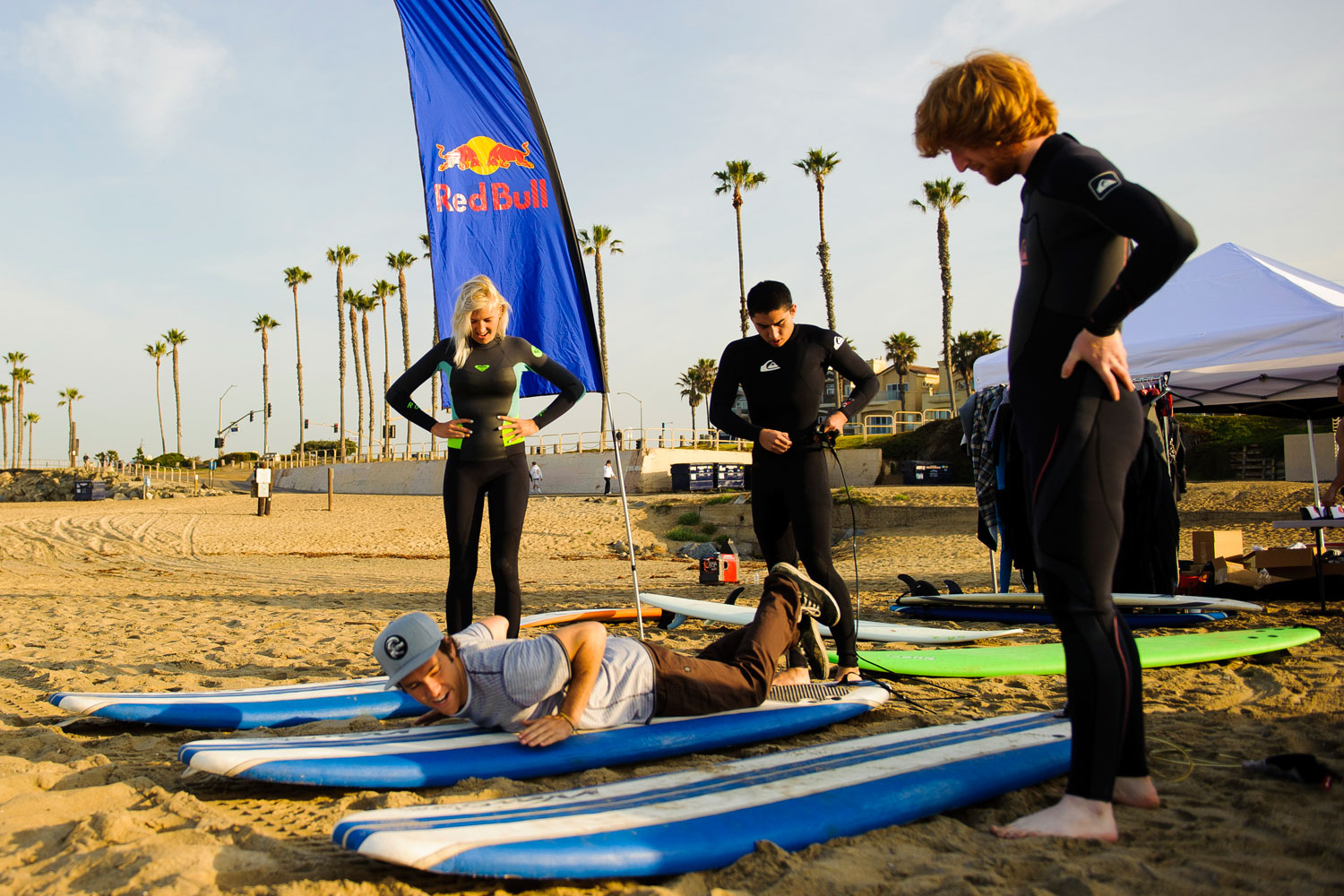 Amateur surfers learn how to paddle out in the water before they enter the waves at Huntington Beach.