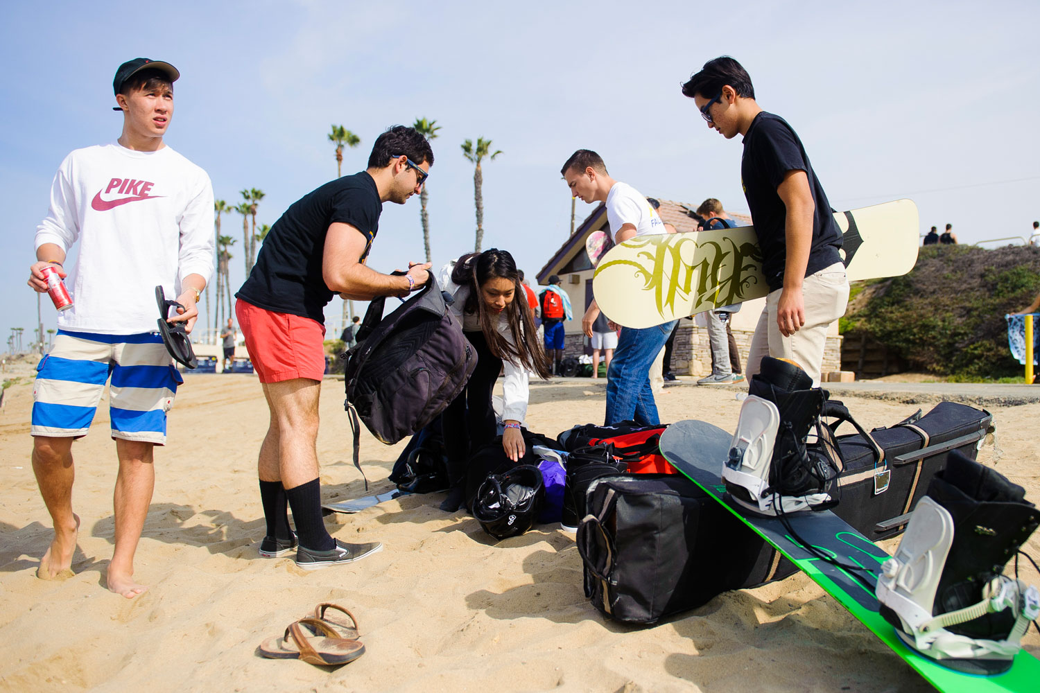 Contestants packing their boards and gear to travel to their next location for some thrills on the slopes.