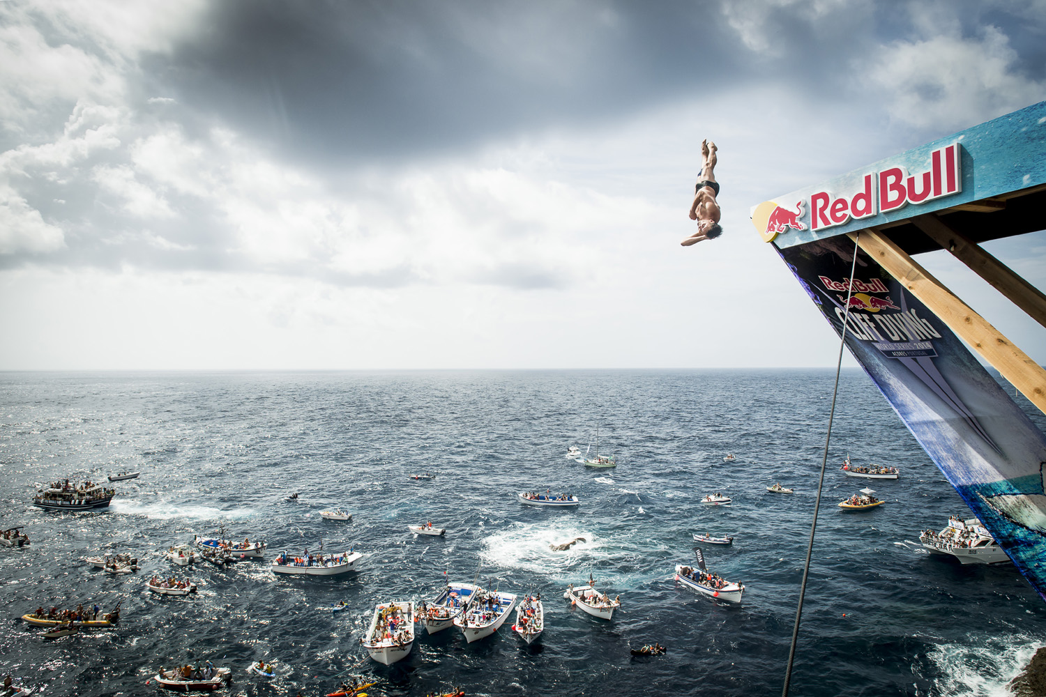 Blake Aldridge dives from the 27 metre platform on Islet Vila Franca do Campo during the fifth stop of the Red Bull Cliff Diving World Series, Azores, Portugal.