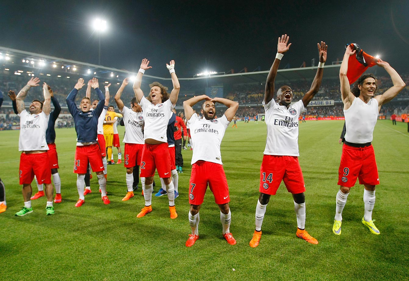 Paris Saint-Germain players celebrate winning the French League One title in France.