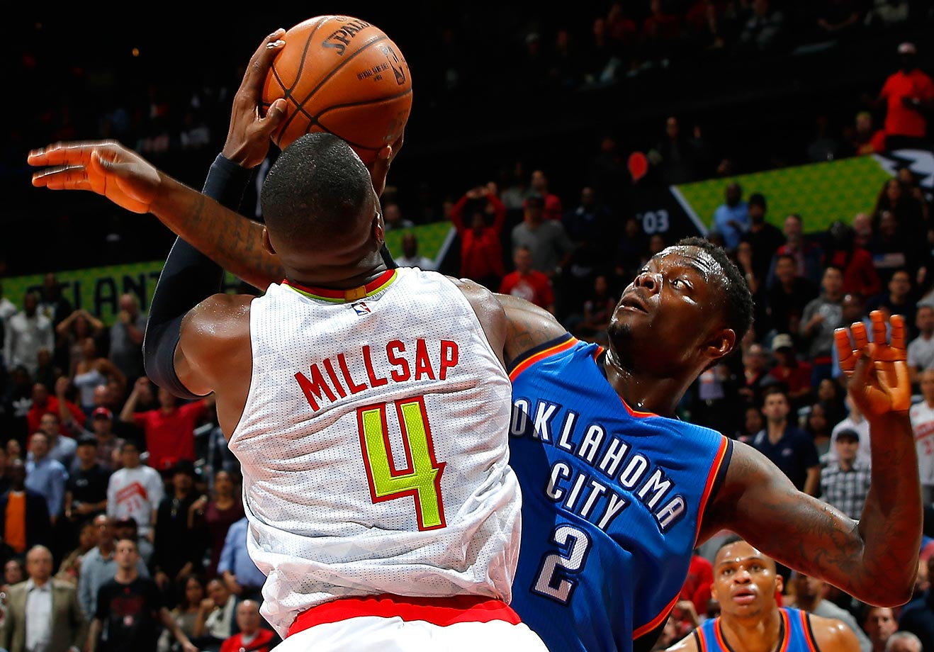 Anthony Morrow of the Oklahoma City Thunder fouls Paul Millsap of the Atlanta Hawks.
