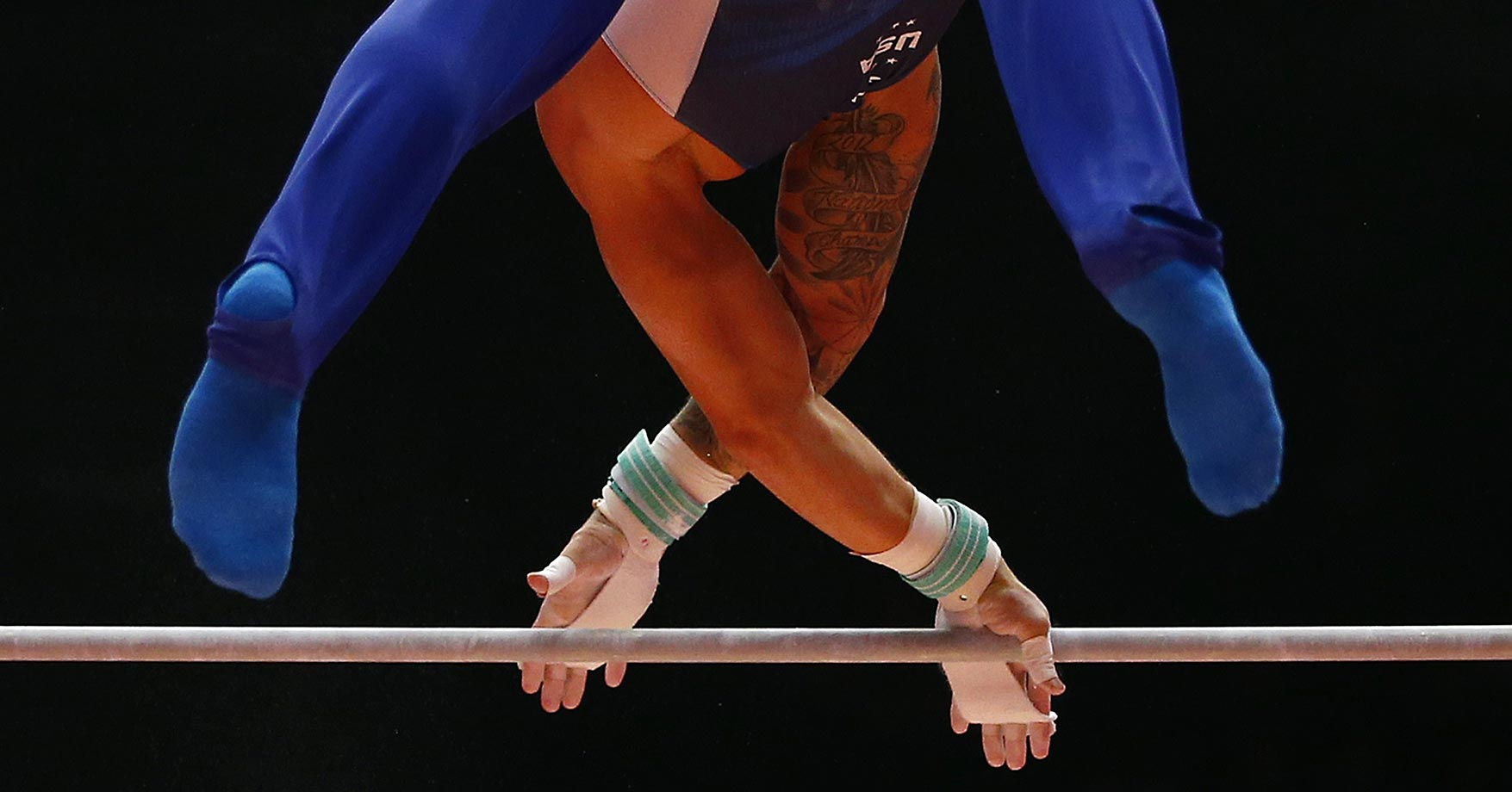 Paul Ruggeri performs on the horizontal bar at the World Artistic Gymnastics championships in Glasgow, Scotland.