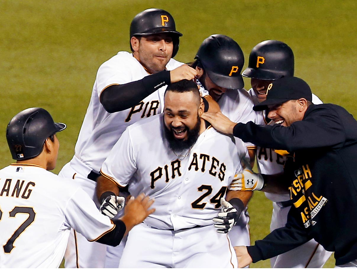 Pedro Alvarez of the Pittsburgh Pirates celebrates with teammates after driving in the game-winning run in the 10th inning against the Los Angeles Dodgers.