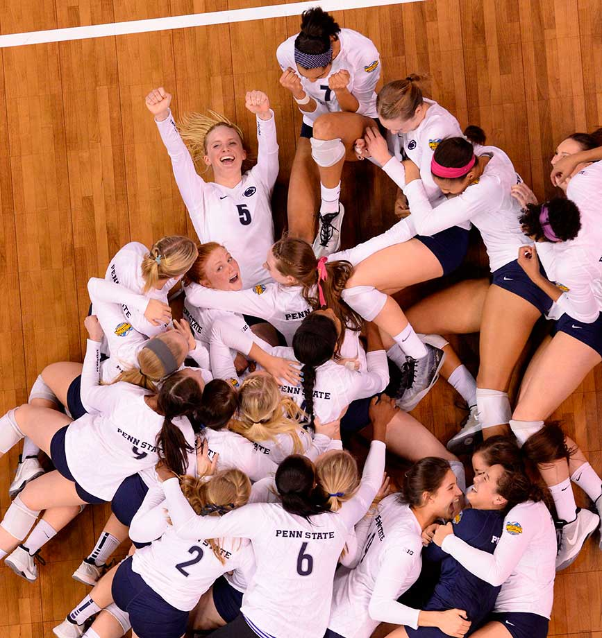 Penn State players celebrate their 2014 national volleyball championship win over BYU.