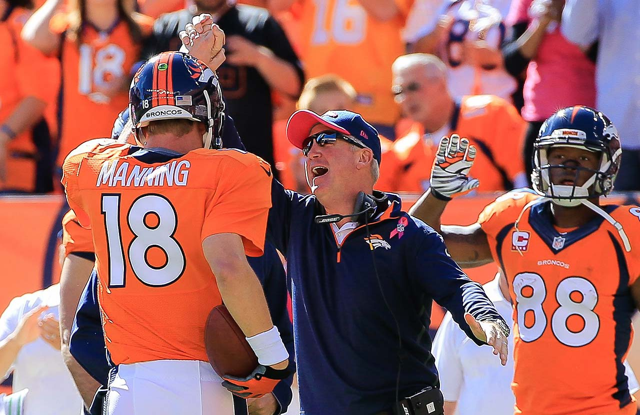 Peyton Manning celebrates his 500th career touchdown pass with head coach John Fox. He finished the day with four TD passes, moving him to within five of Brett Favre's record 508.