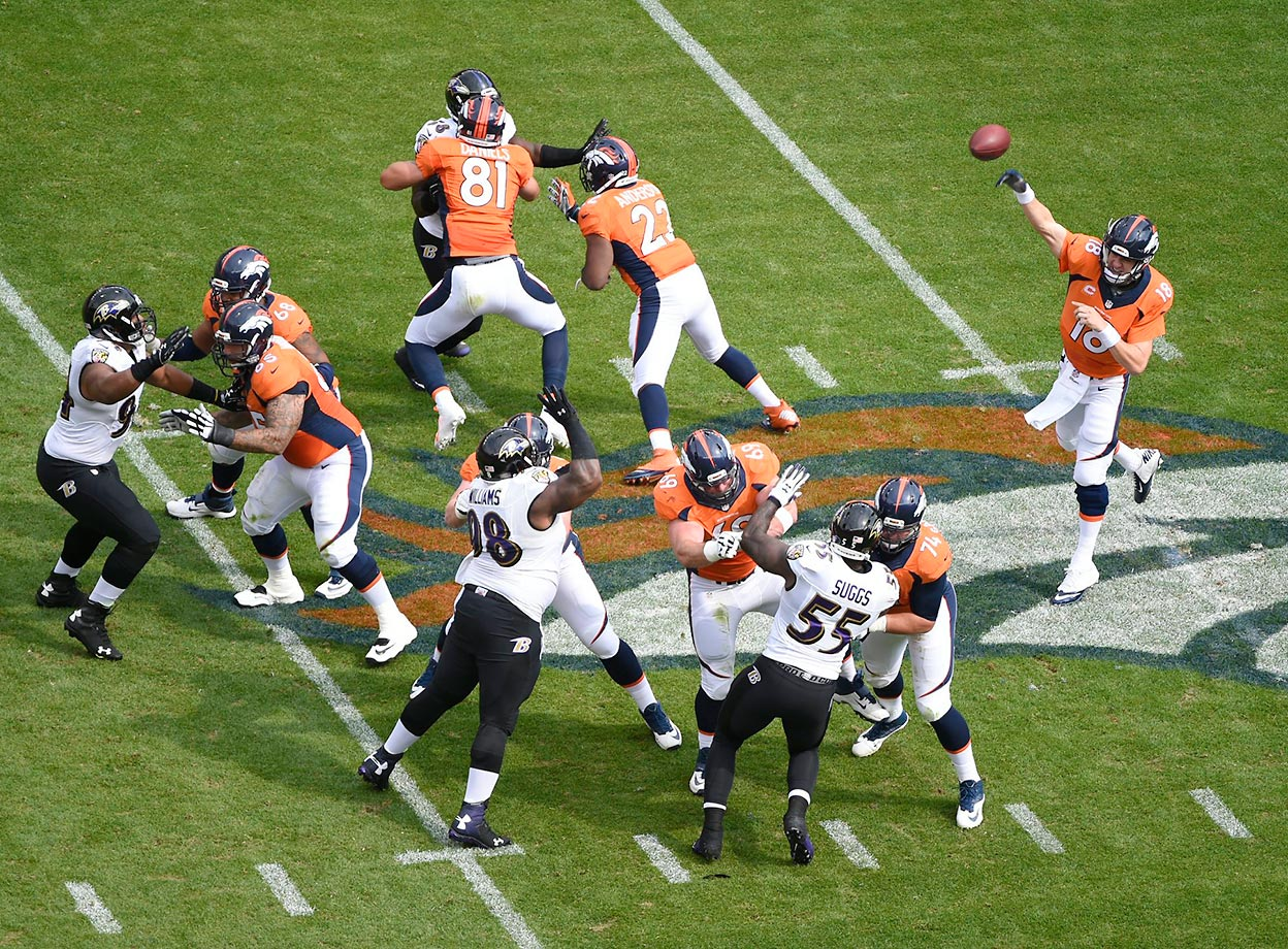 Peyton Manning lets one rip after getting good protection from his line.