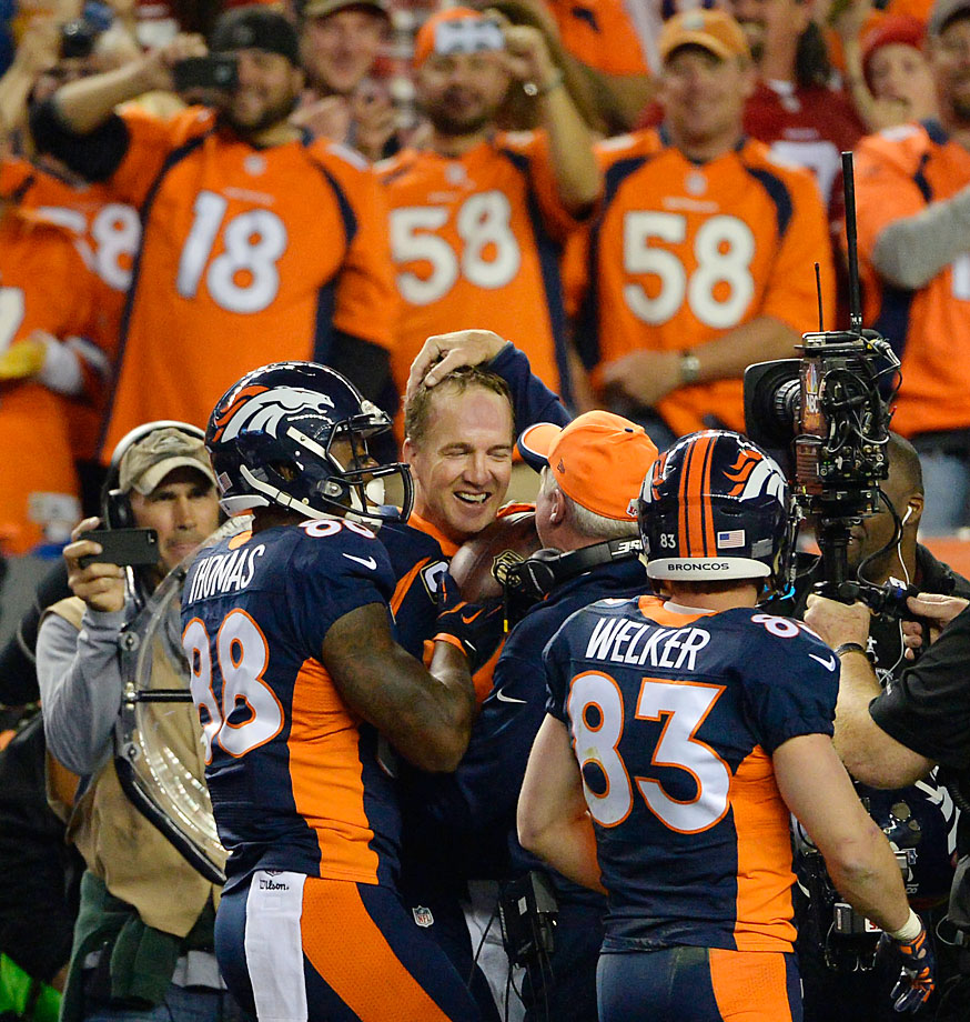Peyton Manning throws his 508th, 509th and 510th career touchdowns, tying and breaking Brett Favre's career touchdown record.
