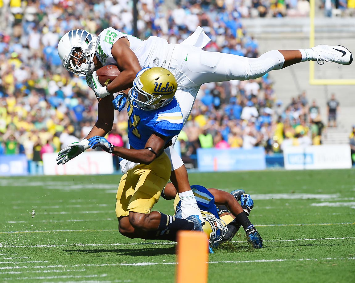 Pharaoh Brown of the Oregon Ducks is hit by UCLA defensive back Tahaan Goodman. Oregon defeated UCLA 42-30 in the Pac-12 matchup.
