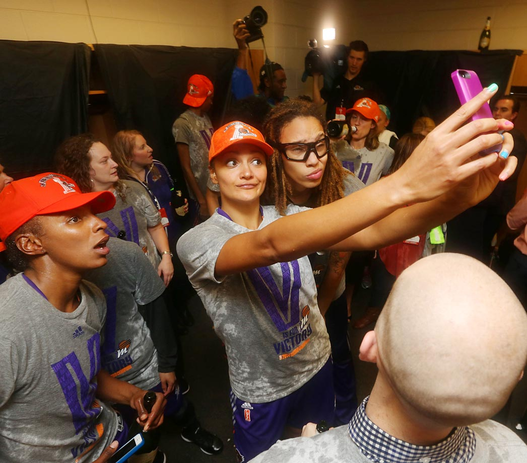 The Phoenix Mercury celebrate in the locker room following Game Three of the 2014 WNBA Finals.