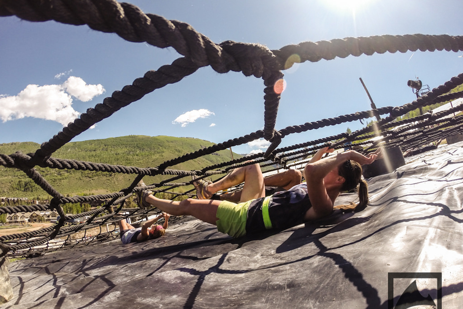 Racers in The Eddie Bauer BADASS Dash slithered underneath a ropes course, one of the event's 25 obstacles.
