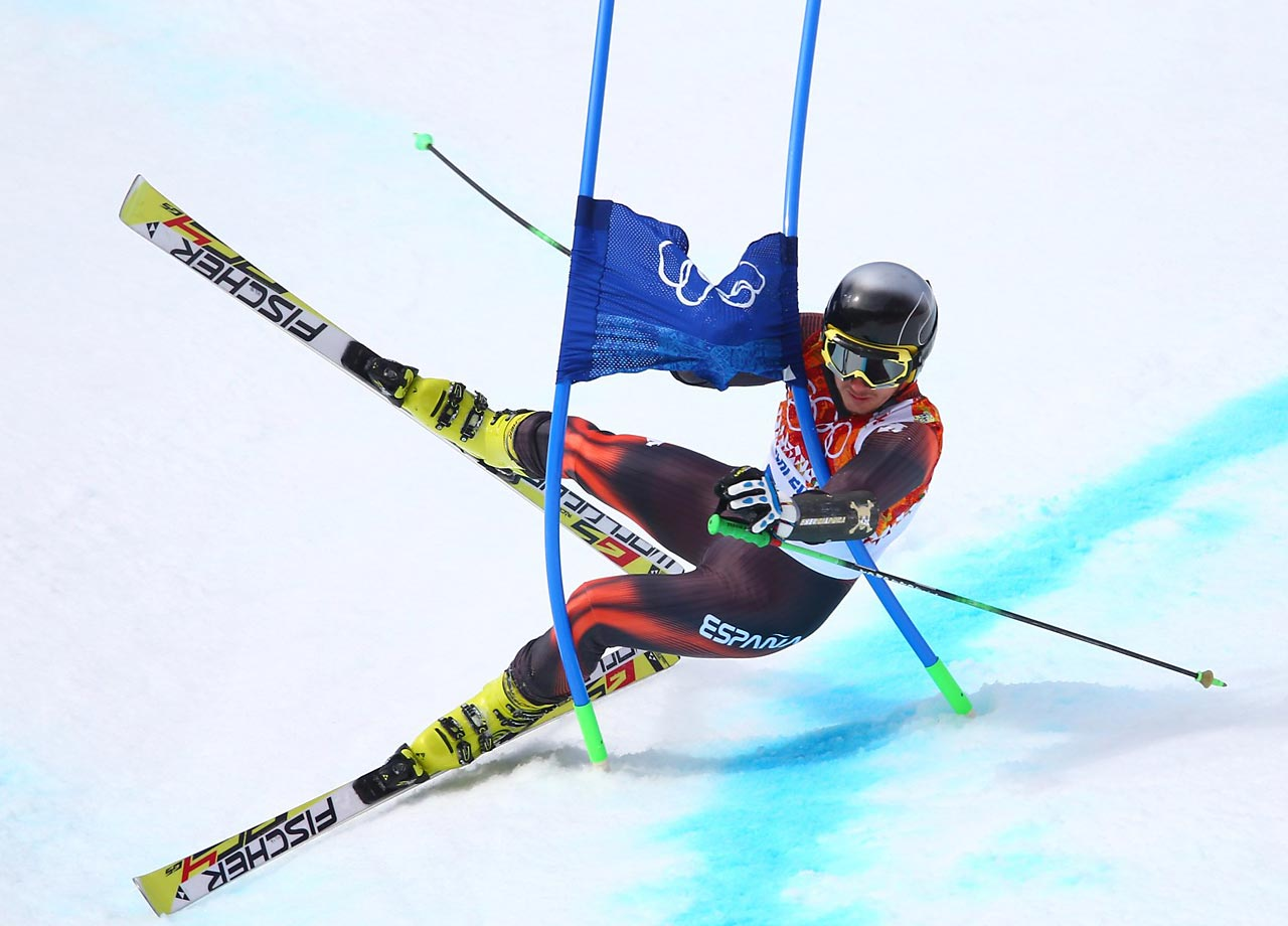 Pol Carreras of Spain crashes during his first run in the giant slalom.