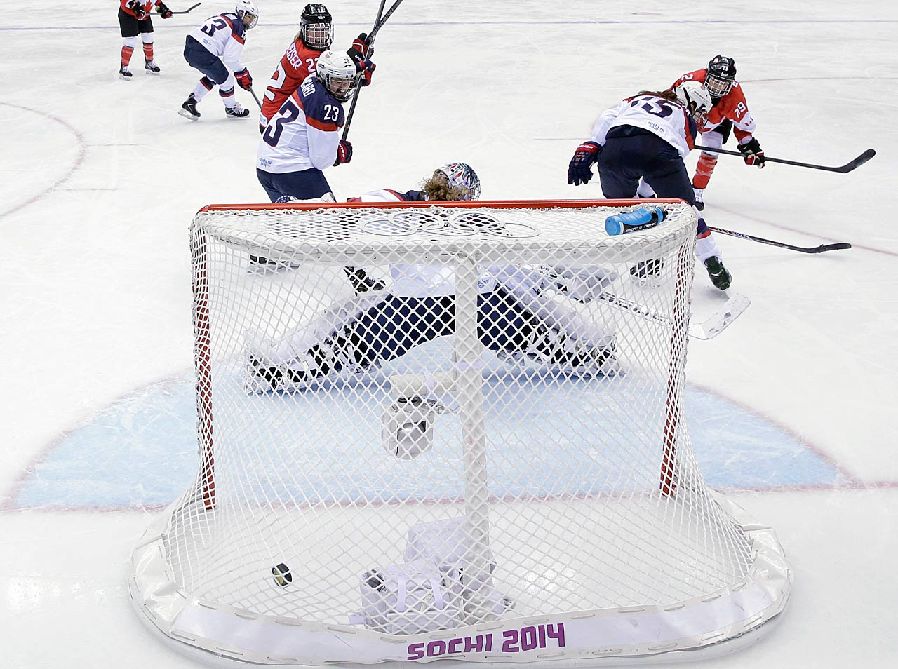 Marie-Philip Poulin of Canada (29) scores the game-winning goal in overtime.