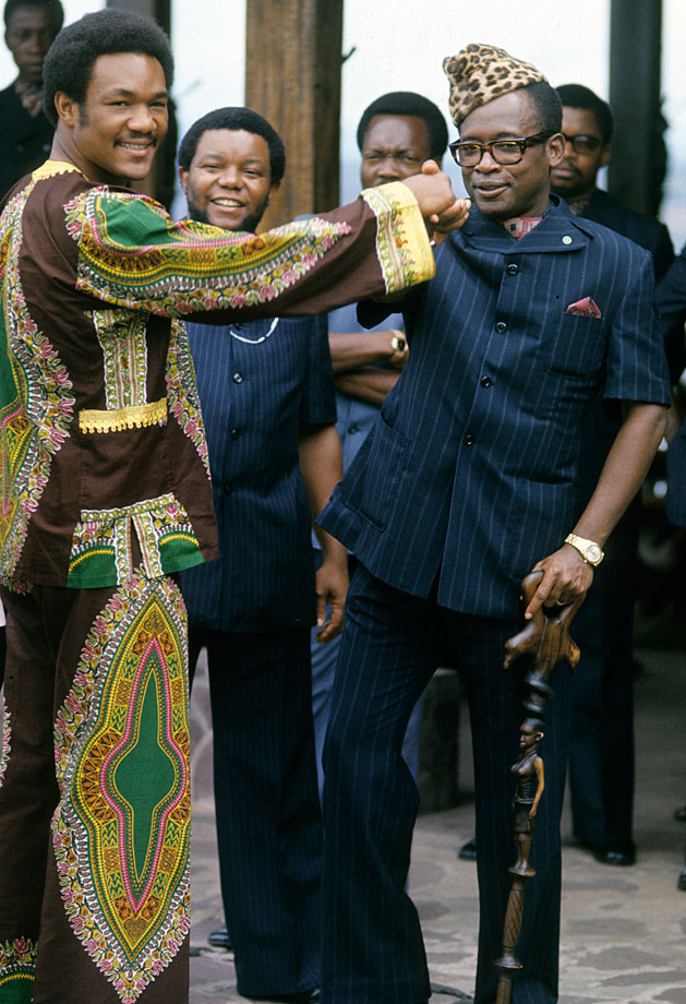 George Foreman, greeted by President Mobutu Sese Seko, also spent most of the summer training in Zaire to adjust to the climate.