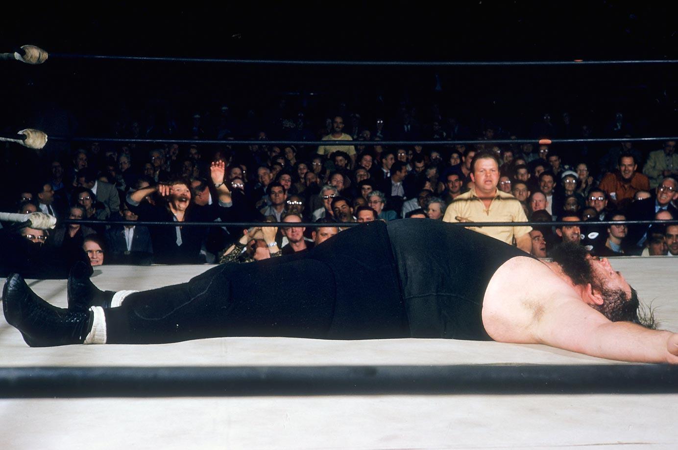 Man Mountain Dean Jr. down on his back during fight against Sandor Szabo.