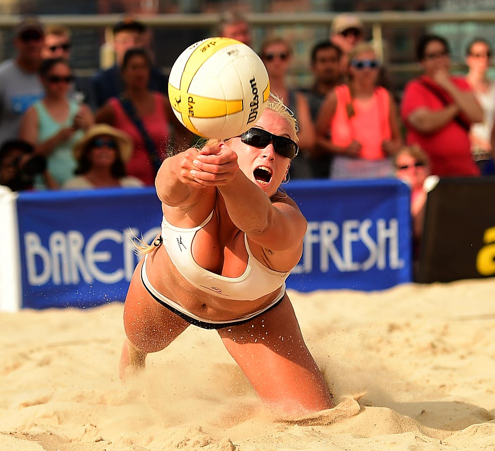 AVP Pro Beach Volleyball held its first-ever tournament in Manhattan last week and photographer Robert Beck was there to capture all of the action. Here, Sara Hughes lays out for a ball. The newcomer from USC battled through the qualifier all the way to the semifinals with partner Kelly Claes.
