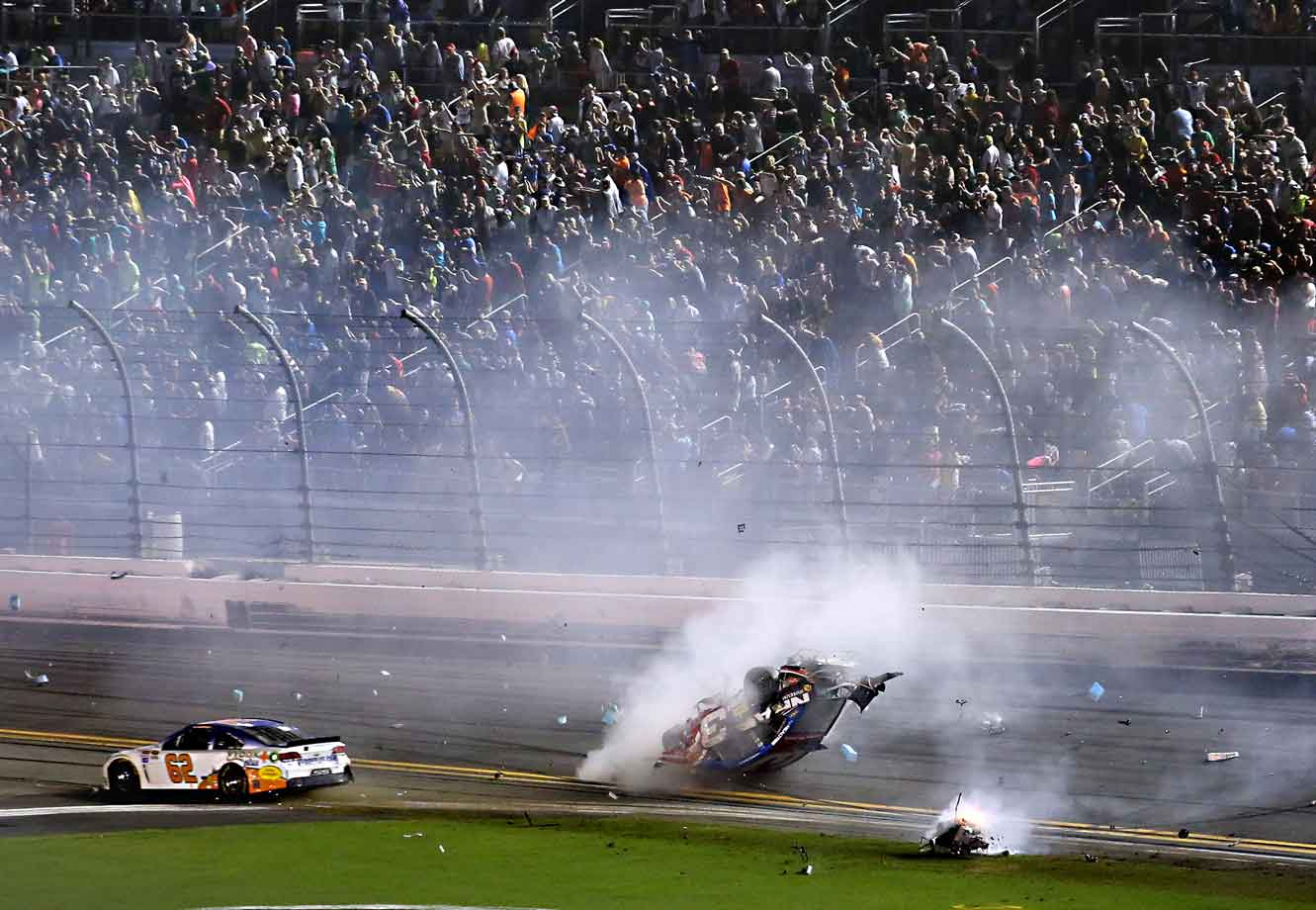 Rain delays were nearly the story of this July race, which started late (at 11:42 p.m. Eastern) and wound down well after bedtime (2:40 a.m.). But on the last lap, a Big One bubbled up just as race leader Dale Earnhardt Jr. crossed the finish line. The chain reaction sent Dillon's No. 3 Chevy soaring off the track and flipping sideways into the Turn 1 catch fence. The car landed back on track, roof-side down, and suffered another hit from the No. 2 car of Brad Keselowski. Dillon walked away unscathed, but some fans behind the fence had to be hospitalized after being struck by debris.