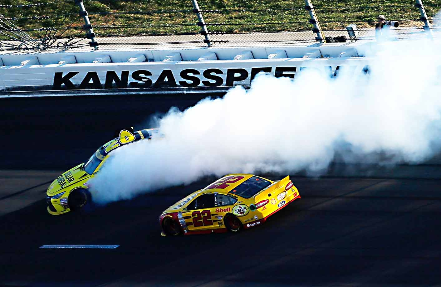 In a Chase race at Kansas, Logano (right) spun out Kenseth late on the way to claiming a checkered flag he arguably didn't need. (Logano had already earned a free pass into the next round; the wreck eliminated Kenseth from playoff contention.) Payback came at Martinsville. Nursing a wounded car 10 laps behind, Kenseth waited for Logano (then leading) to pull alongside, jabbed the nose of his car into right rear of Logano's racer and plowed him into the wall. Kenseth, who walked away OK, was hit with a two-race suspension. Logano's championship hopes were dashed.
