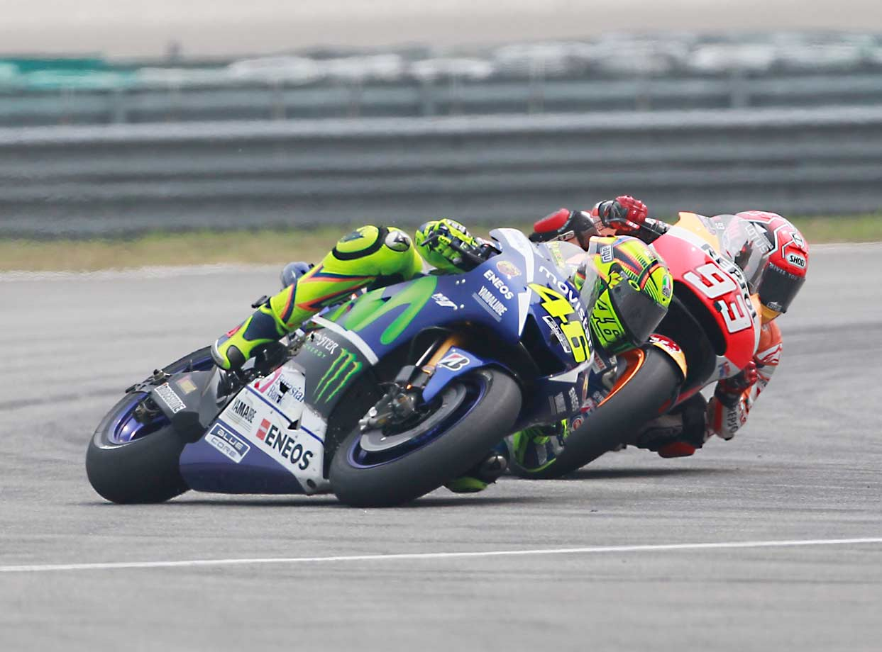 MotoGP stars Valentino Rossi and Marc Marquez ONCE had a friendly rivalry. But this year it took a decidedly sour turn. The nadir came during the Malaysian GP in October—the penultimate race of 2015. During a battle for third place, Rossi, after being reeled in by a fourth-place Marquez through a bend, appeared to kick Marquez out of the way and send him skidding off course and out of his saddle. (Physically at least, Marquez was unhurt.) As intentional roughness penalties in racing go, this one took the cake. (A cyclist's only protection is his helmet, after all.) For his actions, Rossi was docked three points and forced to start the finale at the back of the grid. He'd finish fourth and lose the championship race by five points.
