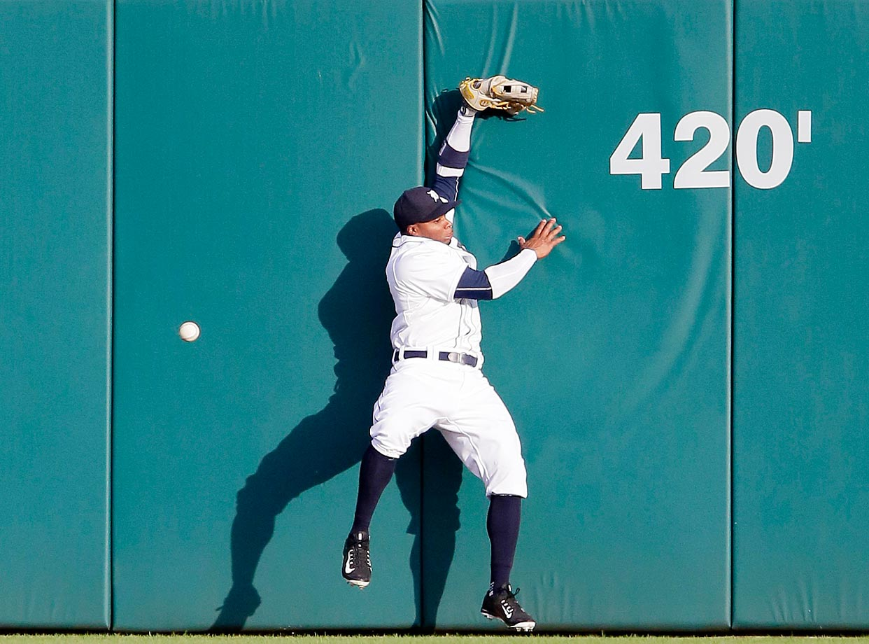 Rajai Davis of the Detroit Tigers misses this leaping attempt against the Seattle Mariners.