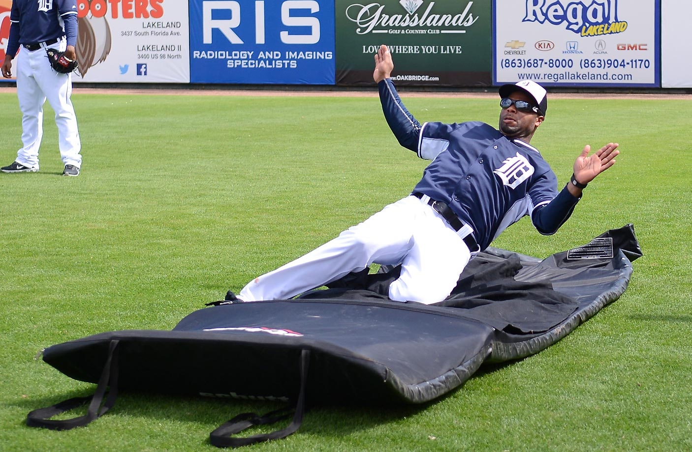 Rajai Davis of the Tigers works on his sliding before a spring training game against the Florida Southern College Moccasins at Joker Marchant Stadium. The Tigers defeated the Moc's 12-2.
